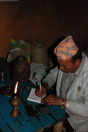 Sher Bahadhur Khadka writing bill at Mude, Sindhupalchowk