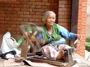 An old woman making a living and she is quite content with it
