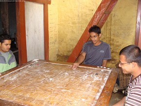 Guys happy playing Carom Board game