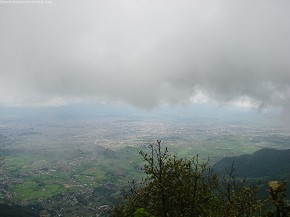 Valley under dark cloud
