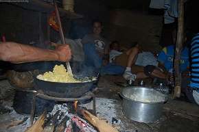 A generous hand preparing corn Porridge for us as dinner