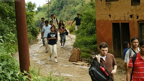 Hikers through village