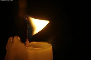burning flag atop the candle