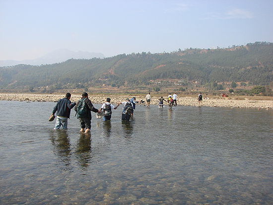 Hikers Crossing Tadi River