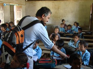 74. Rudra Pandey Distributes Pencils and copies to the school children