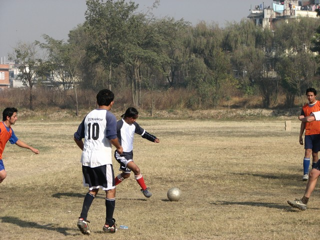Sudeep and Hitesh exchanging passes