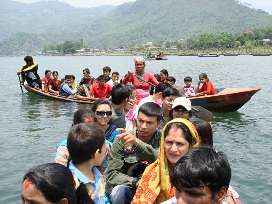 Worshipers Crossing Lake Fewa to reach Taal Baharai Temple, Pokhara