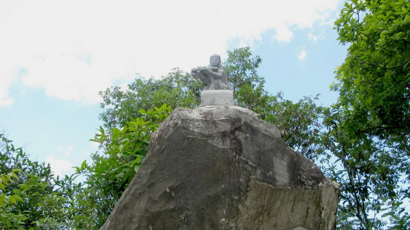 11 statue at the top of rock
