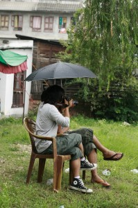 46. Camera man with 2 pair of legs and an umbrella