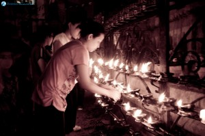 36-women-busy-lighting-butter-lamps