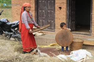 12. Kid helping her mother on work