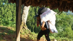 32. Local man carrying goods up, down from Khaireni