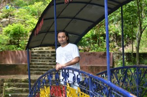 08. Jeevan Timilsina posing at the Arch Bridge