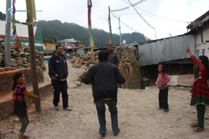 7. Sawan playing skip rope with the local children