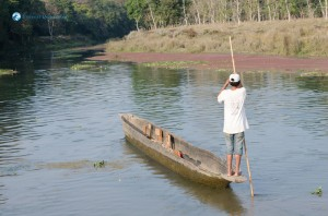 21. Man Pushes His Dugout Canoe Along The Rapti River