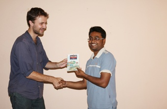 Edward Hausman gives the award to Awanish Ranjan the winner of Deertalk 2013 Season 2