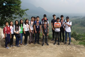 3. Students stop for a group photo during the hike.
