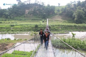 6. Students crossing a suspension bridge on their way to the powerhouse