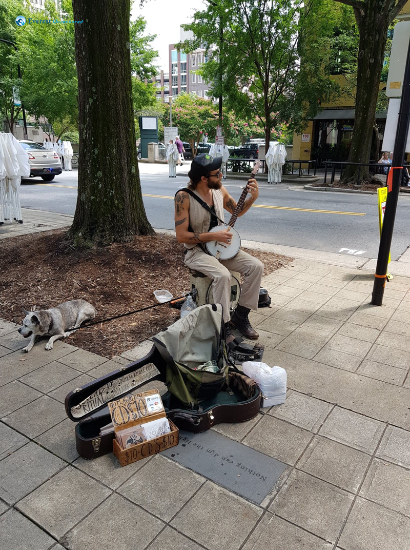A Street Performer With His Dog